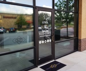 Bee Cave Vinyl Signs Level 12 Salon Door Graphics e1507751628150 300x246